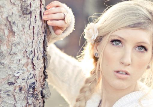 Girl posing by tree