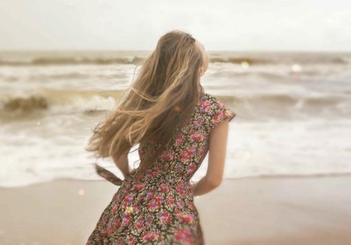 Girl happy on beach