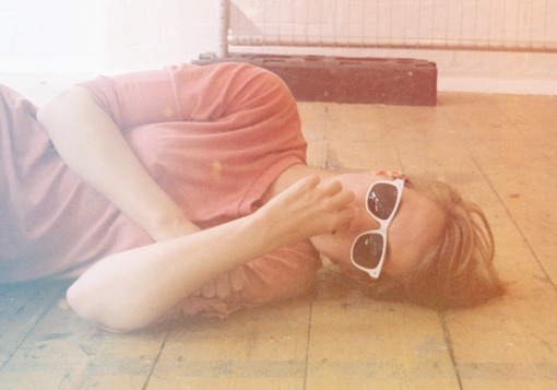 Girl lying on floor with sunglasses | Girl Defined