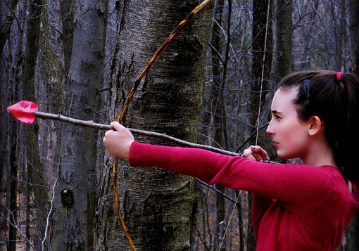 Girl shooting arrow
